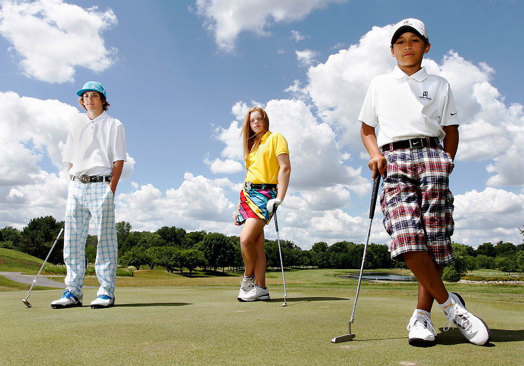 Erik Anderson/Rockford Register Star<br /> Grant Germano, 13, (from left) Maddasyn Pettersen, 12, and Marcus Smith, 10, stand on the putting green Friday, June 22, 2012, at Aldeen Golf Course in Rockford. All three golfers are currently Rockford's greatest golfing prodigies while they are also good friends.