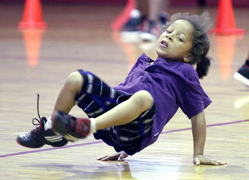 Erik Anderson/Rockford Register Star<br /> Demarjia Brown, 5, break dances after a goal Wednesday, June 20, 2012, at the Blackhawk Boys and Girls Club in Rockford during a community gathering event.
