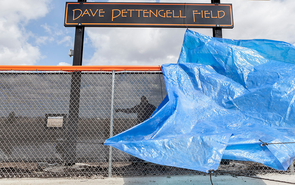 "Erik Anderson - For the Daily Chronicle <br /> Associate Athletic Director Mark Sykes helps release the blue tarp to showcase the new ""Dave Pettengell Field"" sign at DeKalb High School on Saturday, April 20, 2013."