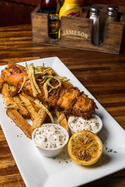 Fish and Chips - Hand battered Haddock, served with fresh cut English chips, a grilled lemon and home made tartar sauce.