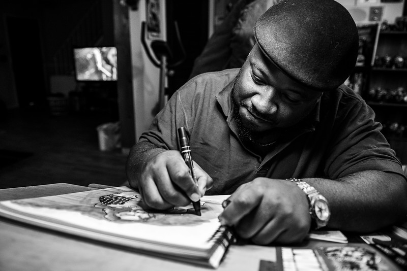 Corey Davis drawing in his home studio on March 27, 2019.