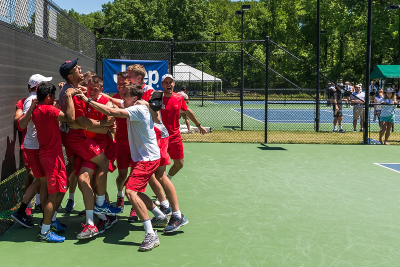 St. John's players surround Aditya Vashistha after scoring the team's final point to win Big East Tennis Championship over Marquette at Cayce Tennis & Fitness Center, on April 22, 2019. John A. Carlos II for The Big East Conference