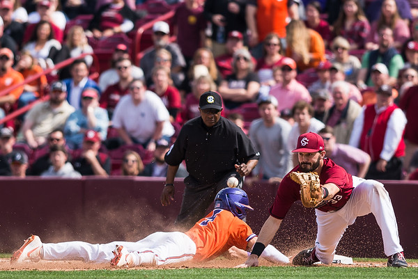 Sam Hall slides back to first base in time, before Gamecock first baseman Chris Cullen can tag him out, on March 3, 2019. John A. Carlos II / Special to The Post and Courier
