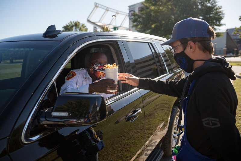 Columbia South fire chief Aubrey D. Jenkins get some Fiske Fries on the opening day of the drive-thru State Fair on Monday Oct. 19. John A. Carlos II / Special to The Post and Courier