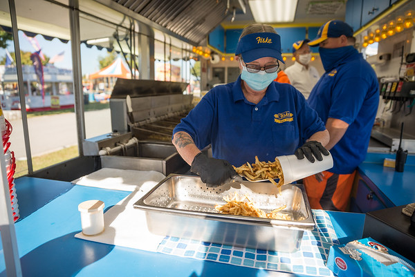 33 years Fiske Fries veteran Betty Collins, serves up the famous fries on the opening day of the drive-thru State Fair on Oct. 19. John A. Carlos II / Special to The Post and Courier