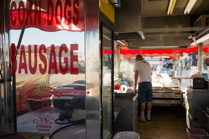 Ralph West cook sausages at Aunt Martha's famous foods on the opening day of the drive-thru State Fair on Monday Oct. 19. John A. Carlos II / Special to The Post and Courier