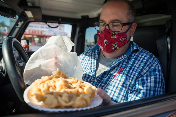 Post and Courier writer Chris Trainor, orders a funnel cake on opening day of the drive-thru State Fair on Monday Oct. 19. John A. Carlos II / Special to The Post and Courier