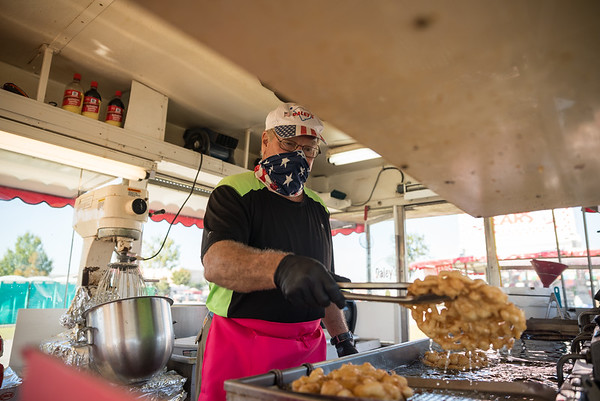A Daley's worker makes a funnel cake on the opening day of the drive-thru State Fair on Monday Oct. 19. John A. Carlos II / Special to The Post and Courier