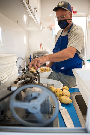 Kelly Felger cuts potatoes at Fisk French Fries on the opening day of the drive-thru State Fair on Monday Oct. 19. John A. Carlos II / Special to The Post and Courier