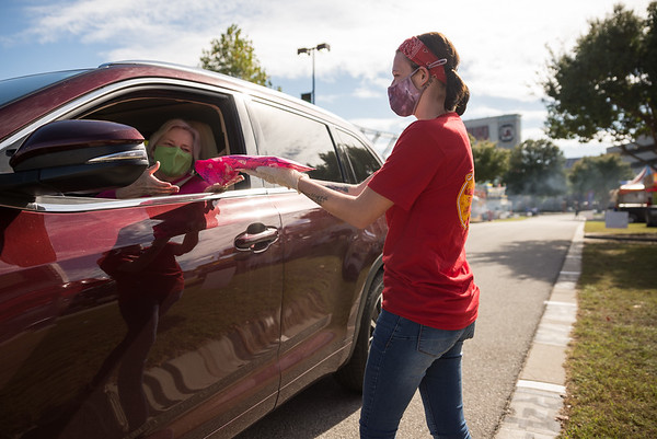 Nyssa Govert delivers an elephant ear on the opening day of the drive-thru State Fair on Monday Oct. 19. John A. Carlos II / Special to The Post and Courier