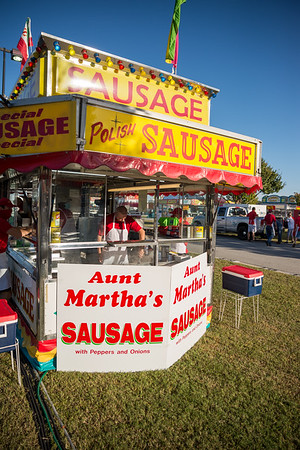 Robert Donley, a 55 year the State Fair worker, cooks sausages at Aunt Martha's famous foods on the opening day of the drive-thru State Fair on Monday Oct. 19. John A. Carlos II / Special to The Post and Courier