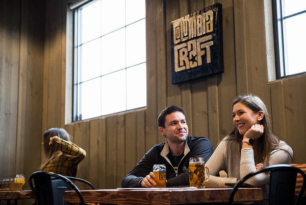 Courtney Linenbrink and Will Jordan, enjoy brews at Columbia Craft. John A. Carlos II / Special to The Free Times