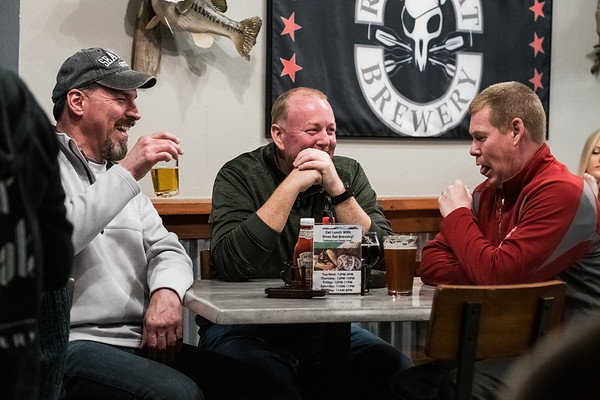 Mike Vukovich, James Manning and Eric Manning, enjoy some local brews at River Rat Brewery in Columbia on Feb. 08, 2020. John A. Carlos II/Special to the Free Times