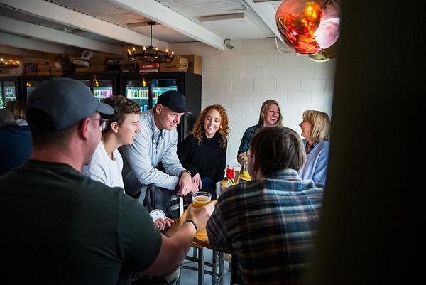 Darcy Lock, Laura Watford, Alan Andrews, Aj Andrews, Warty Watford, Derek Andrews and Jean Andrew, enjoy some beers at WECO Bottle and Biergarten. John A. Carlos II / Special to The Free Times