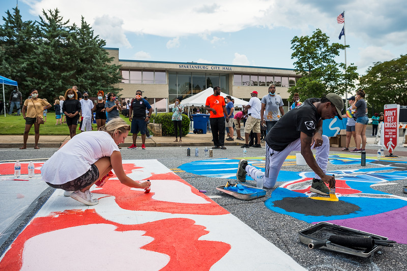 """Sixteen artist collaborated to paint a """"Black Lives Matter"""" mural in front of Spartanburg's City Hall, on June 20, 2020. John A. Carlos II"""