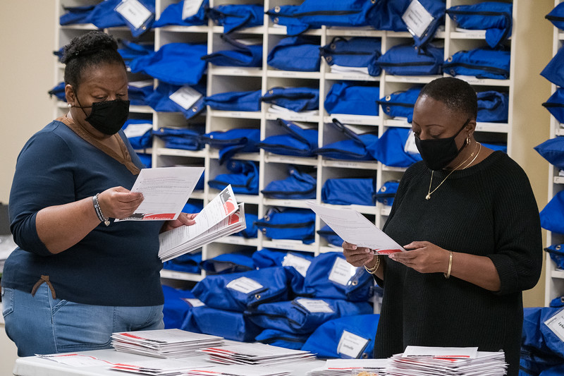 Election workers sort provisional ballot envelopes at the Richland County Administration Building in the election commission office in Columbia on Wednesday, November 4. John A. Carlos II / Special to The Post and Courier