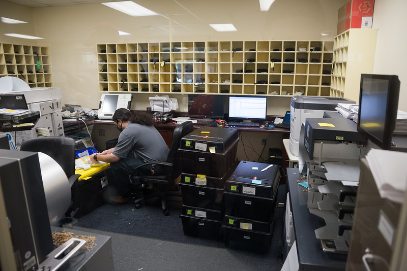 Jesse Hinson loads in person absentee ballot voter records from the absentee satellites offices at the Richland County Administration Building in the election commission office in Columbia on Wednesday, November 4. John A. Carlos II / Special to The Post and Courier