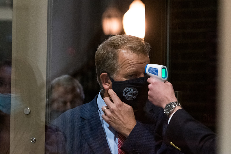 A person has their temperature check at the front door of the South Carolina Republican Party election night watch party held at UofSC Pastides Alumni Center in Columbia, SC, on Tuesday, Nov. 3. John A. Carlos II / Special to The Post and Courier