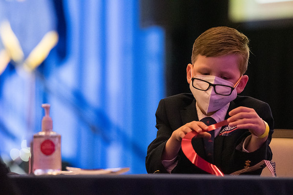 A kid plays with a decorative ribbon at the S.C. Republican Party election night watch party held at UofSC Pastides Alumni Center in Columbia, on Tuesday, Nov. 3. John A. Carlos II / Special to The Post and Courier