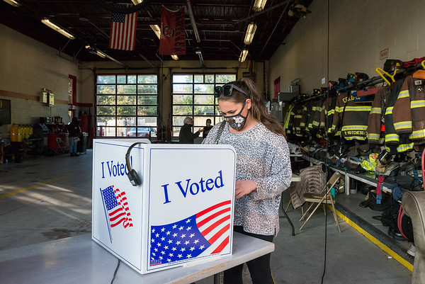 A Richland County resident submits his vote at the Shandon Fire Station in Columbia, SC, on Tuesday, Nov. 3. John A. Carlos II / Special to The Post and Courier