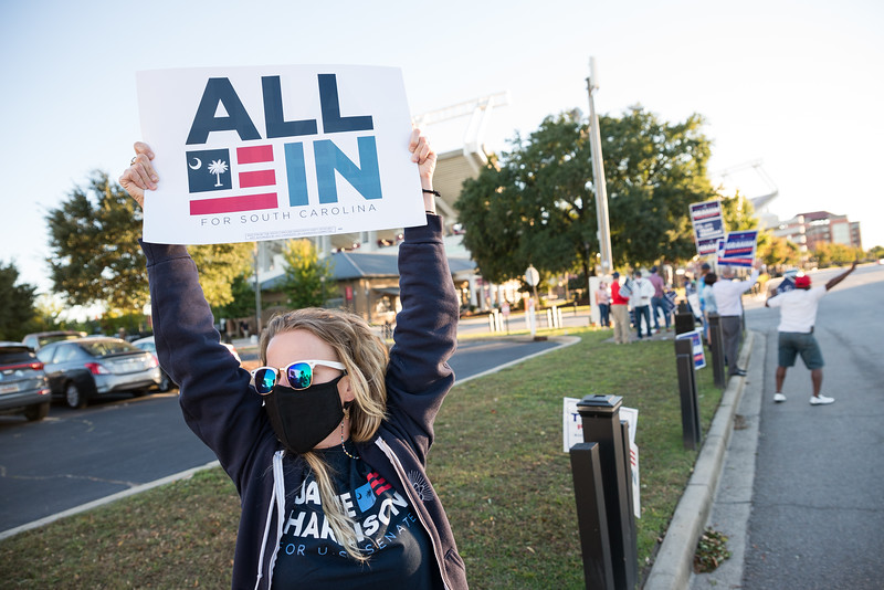 Gillian Bergeron encourages cars passing to show their support for Jamie Harrison, outside of S.C. ETV studios in Columbia,S.C., Friday October 30, 2020. John A. Carlos II/Special to The Post and Courier