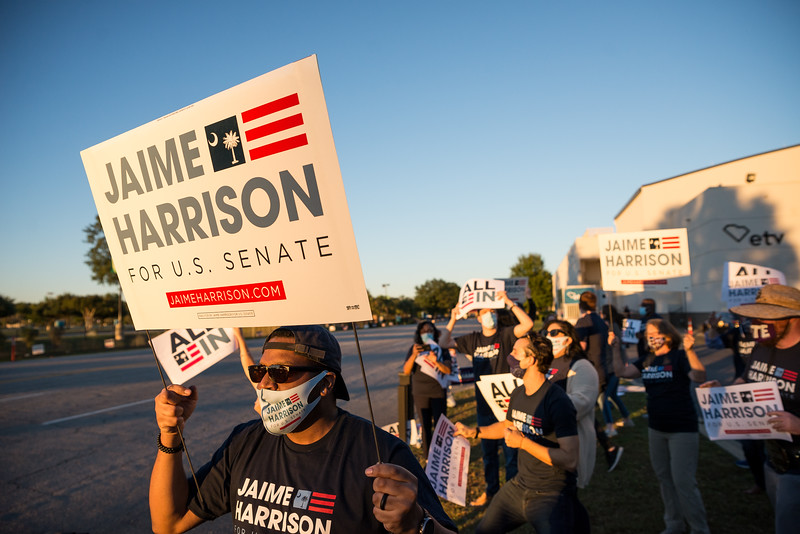 A group of Jamie Harrison supporters shout slogans at passing cars outside of S.C. ETV Studios in Columbia, S.C. the site of a debate between U.S. Sen. Lindsey Graham, R-S.C., and Democratic challenger Jaime Harrison, on Friday October 30, 2020. John A. Carlos II/Special to The Post and Courier