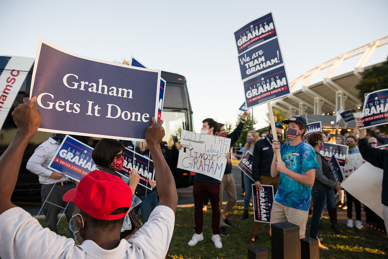 A group of Lindsey Graham supporters shout slogans at passing cars outside of S.C. ETV Studios in Columbia, S.C. the site of a debate between U.S. Sen. Lindsey Graham, R-S.C., and Democratic challenger Jaime Harrison, on Friday October 30, 2020. John A. Carlos II/Special to The Post and Courier