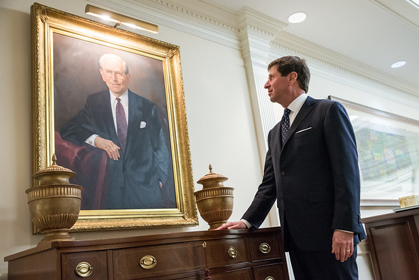 Columbia developer Bill Stern looks at a portrait of his father Ben Stern in the lobby of Stern Development offices in Columbia on Nov. 5. John A. Carlos II/Special to the Post and Courier