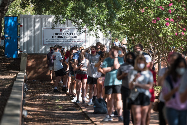 Students at The South Carolina University line up to take COVID-19 test on Davis Field outside of Thomas Cooper Library on Sept. 2, 2020. John A. Carlos II/ Special to The Post and Courier