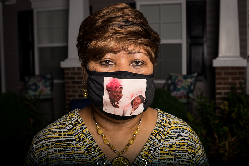 Martha Jones wears a mask with photos of Shirley and Demetria Banister. John A. Carlos II / Special to The Post and Courier