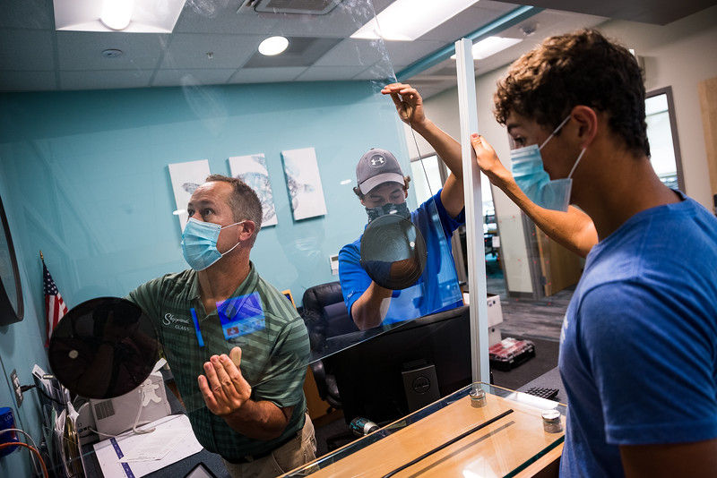 Calvin, Bryson and Blake Sheppard, install a glass partition to the front desk at Riverbank Elementary School on July 30, 2020. John A. Carlos II / Special to The Free Times