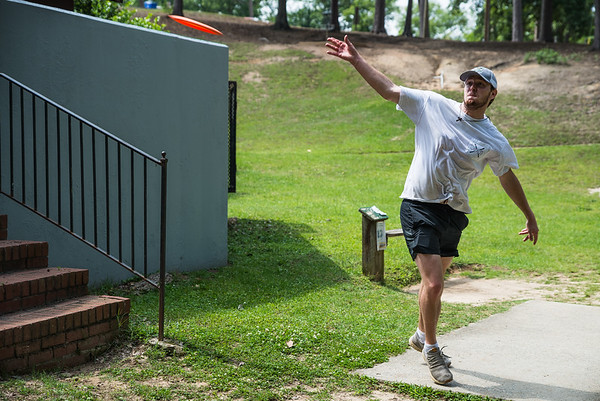 Trevor Beckham undergrad student at University of South Carolina plays disc golf at Earlwood park. John A. Carlos II / Special to The Free Times