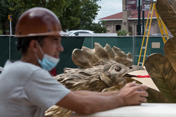 Chris Seinar of Penn Contracting LLC stands next to an 800 square-foot sculpture outside of Williams-Brice Stadium in center of the Lloyd Family Courtyard, on Sept. 10, 2020. John A. Carlos II / Special to The Post and Courier