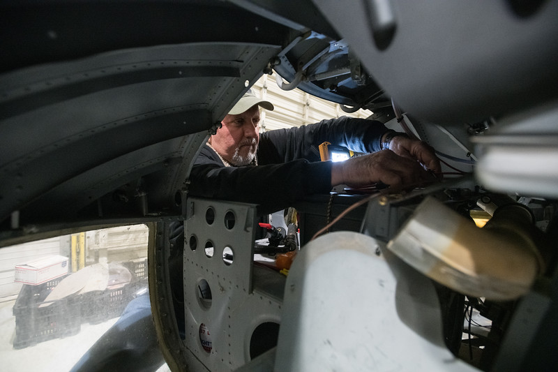 """Larry Quinn, a volunteer at the Celebrate Freedom Foundation, installs a battery switch onto a Bell UH-1A """"Huey."""" John A. Carlos II / Special to The Post and Courier"""