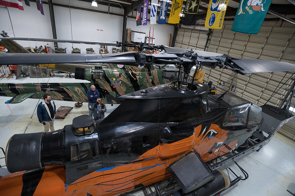 Lori Wicker talks about an AH-1F Cobra in Celebrate Freedom Foundation's hanger at Columbia Metropolitan Airport. John A. Carlos II / Special to The Post and Courier