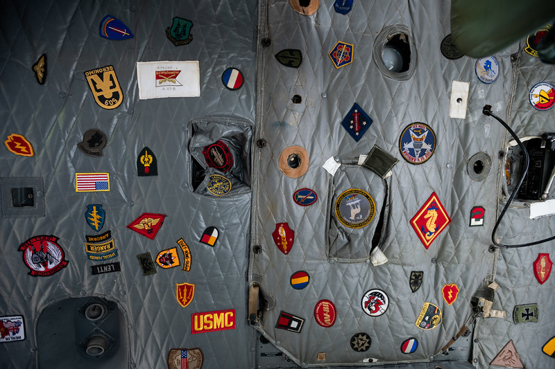 """Patches of various military units lined the ceiling of a Bell UH-1H """"Huey"""" at the Celebrate Freedom Foundation. John A. Carlos II / Special to The Post and Courier"""