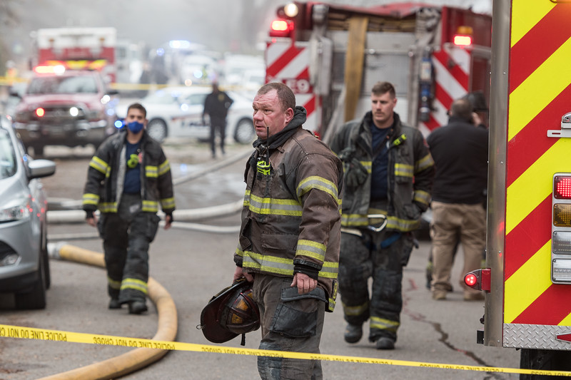 Emergency personnel work at a house on Kennedy Street in the Rosewood neighborhood were a small airplane crashed into a house on Wednesday, Jan. 13. John A. Carlos II / Special to The Post and Courier