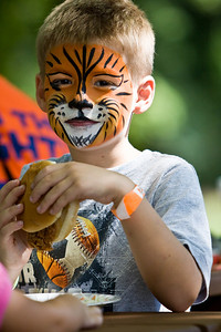 Tigerfaced Matthew Maloney enjoys a pork bbq sandwich.
