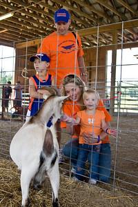 the Tanksleys feed the goats - Austin , Mike, Sharon, Alyssa.