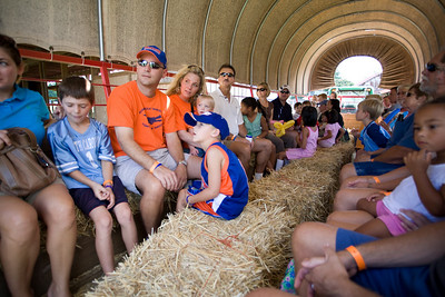 Tanksley family and others on hayride to pet the animals.