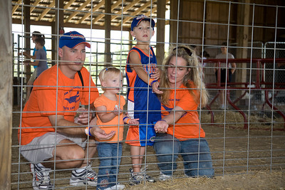 The Tanksleys feed the goats (left to right) Mike, Alyssa, Austin and Sharon.