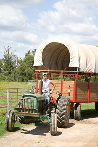 Jonathan Shelton(sp?) drives a tractor for the hayride.