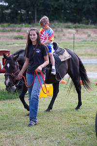 Jack Ransom rides a pony.