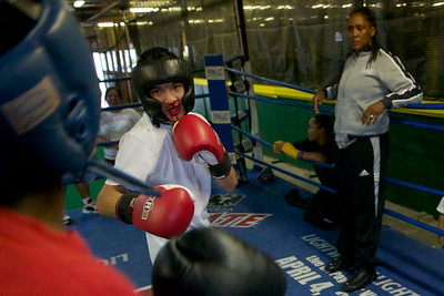 Ann looks on as two of the young boxers face off.