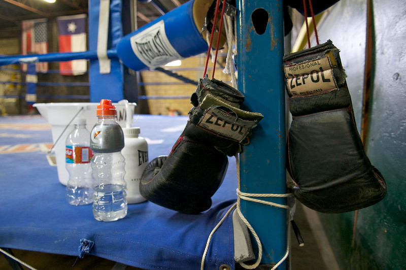 An old pair of boxing gloves hangs off the corner of the practice ring.