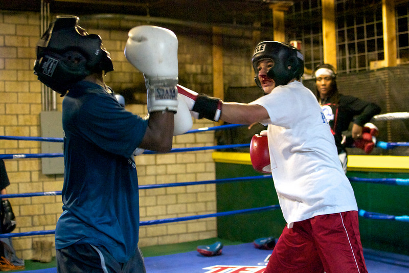 Two young boxers spar.