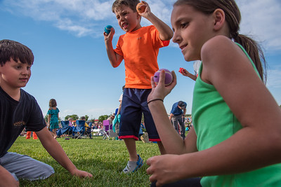 Jack Bell, 10, Sawyer Meyer, 6, and Samantha Wilcox, 10, throw baseballs at a target during the Windsor Summer Concert Series in Boardwalk Park on Thursday, June 22, 2017.