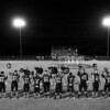 The Buckholts Badgers six-man football team stands in front of their crowd during the singing of the national anthem before their October 22, 2010 game vs. the Oglesby Tigers. Buckholts won 70-0 after the game was called at halftime due to the 45 point six-man football mercy rule.