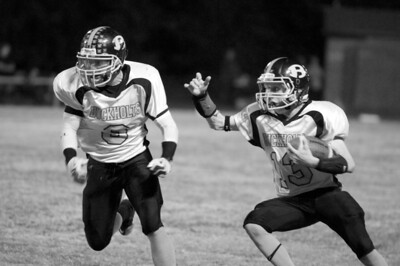 October 8, 2010 - Cade Cowan cuts across the field during a run against the Cranfills Gap Lions.  Buckholts won 65-20 in a game ended in the fourth quarter because of the six-man mercy rule.