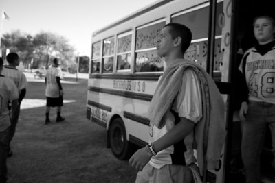 Quarterback William Watson spits as he walks off the bus before their final regular season game against division rival, Calvert, on November 5, 2010.